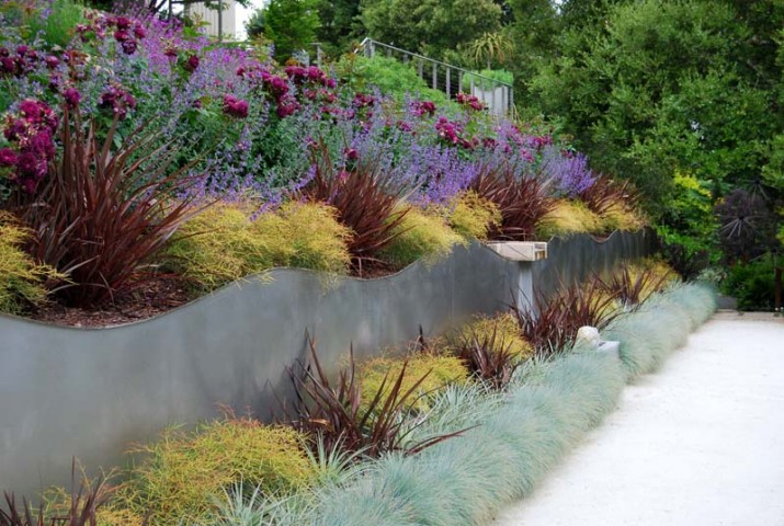 Garden Designers a difficult slope is tamed with stone terraces and colorful xeric plants Garden Designers Roundtable Favorite Gardens