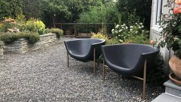 garden makeover-removing pools-garden urn-fountain urn-pea gravel -galanter and jones heated chairs