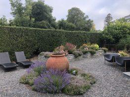 garden makeover-removing pools-garden urn-fountain urn-pea gravel -northern california